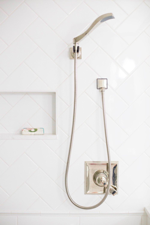 bathroom with herringbone tile