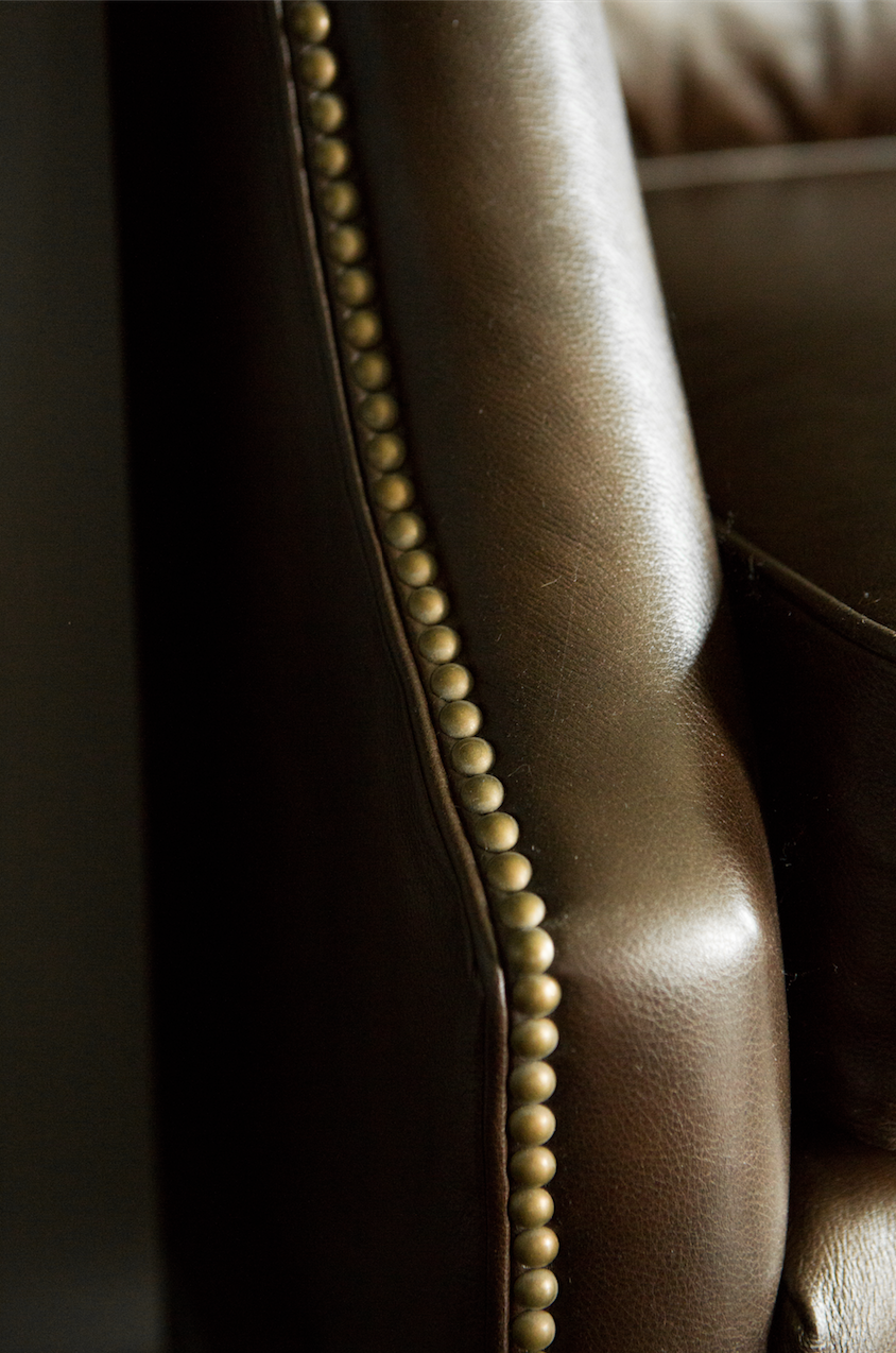 leather sofa with nail heads