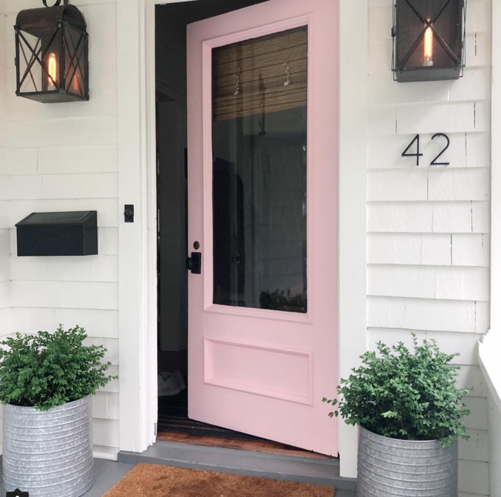 white house with pink door