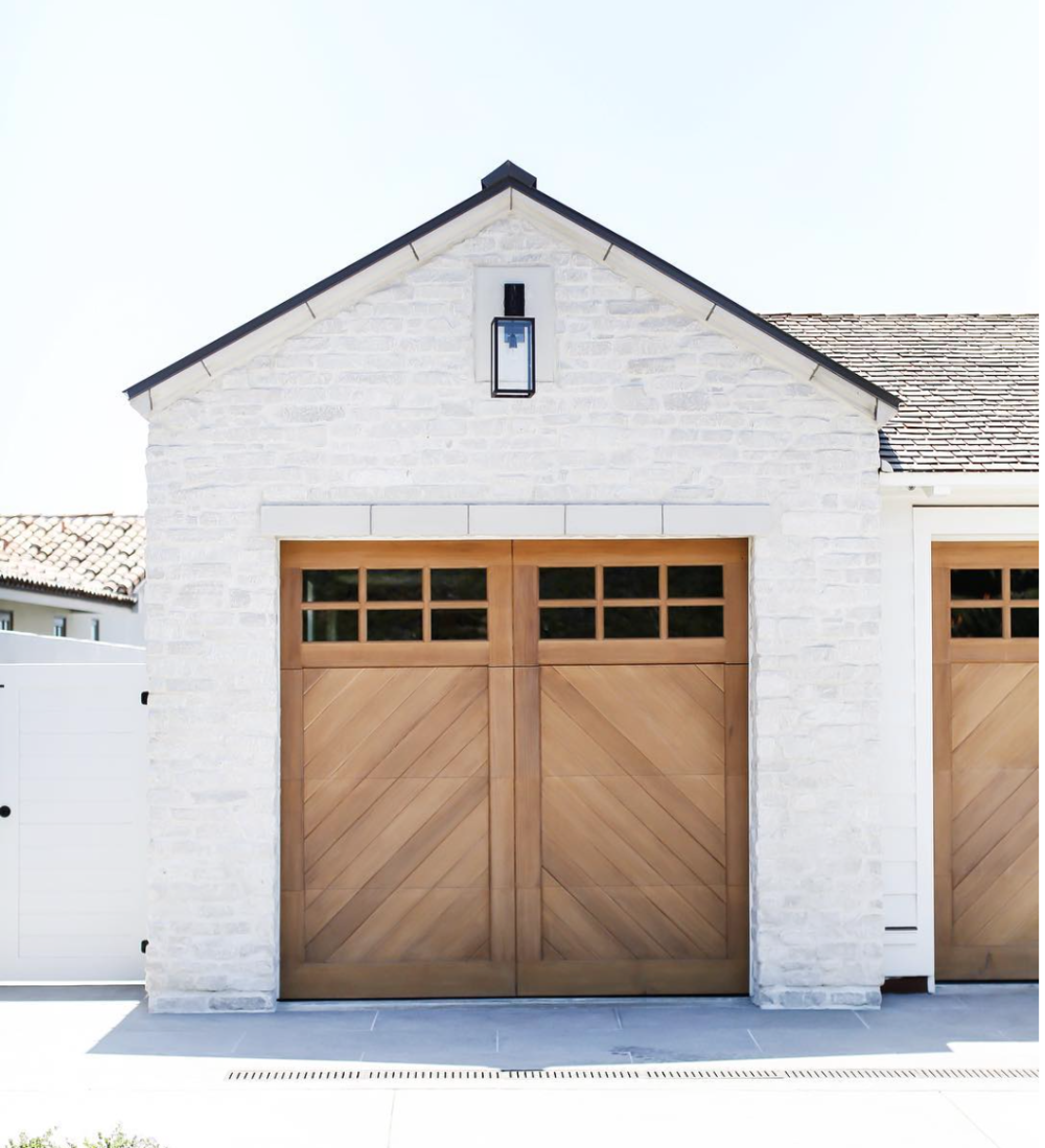 white garage with stained garage door