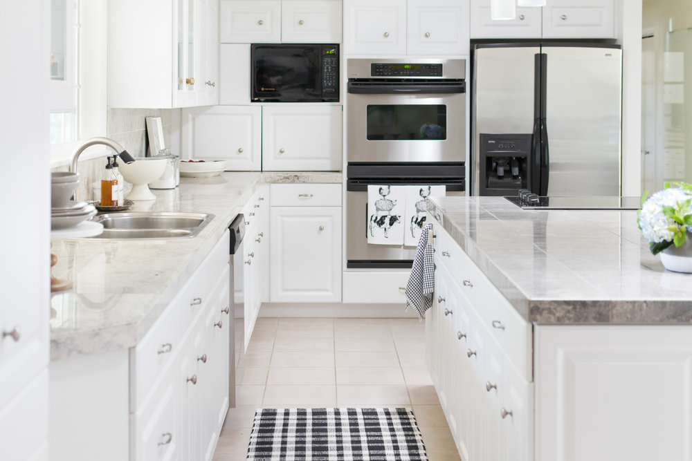 kitchen with black and white rug