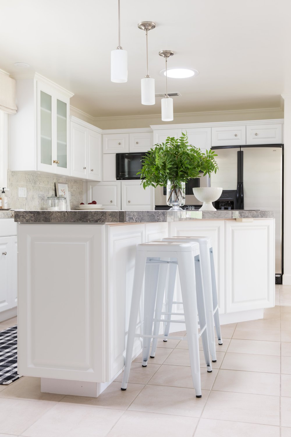 white kitchen with white counter stools