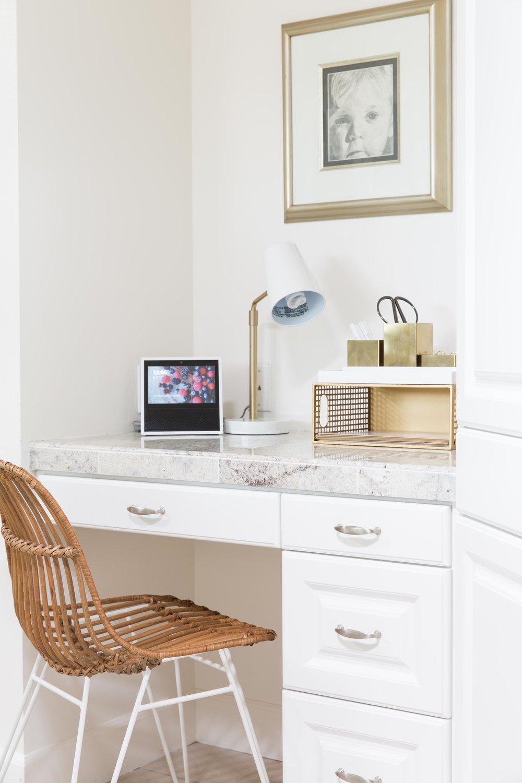 white kitchen with desk