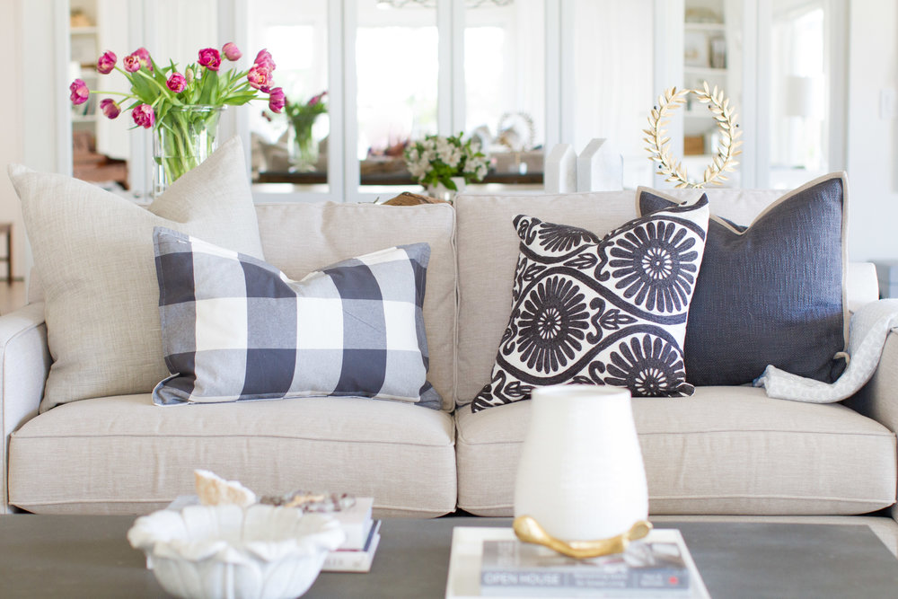 living room with navy pillows