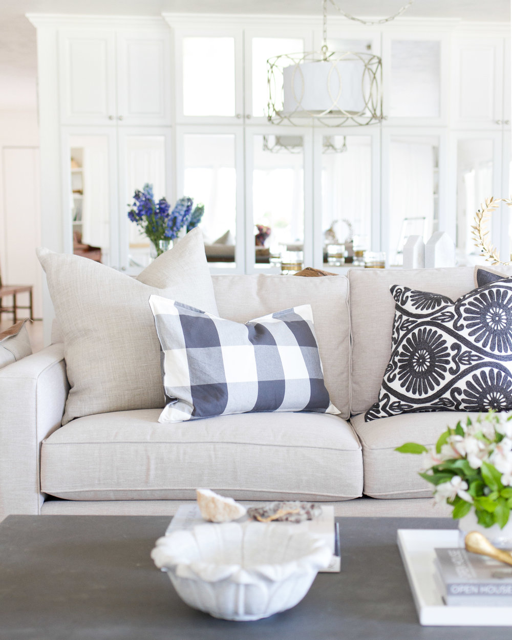 living room with linen sofa and navy pillows
