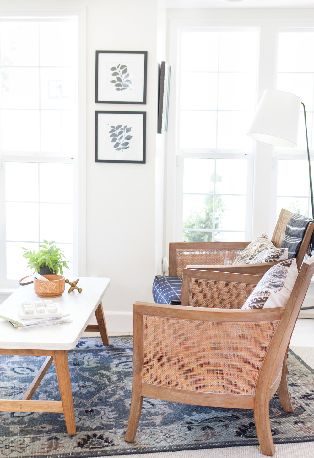 family room with woven chairs