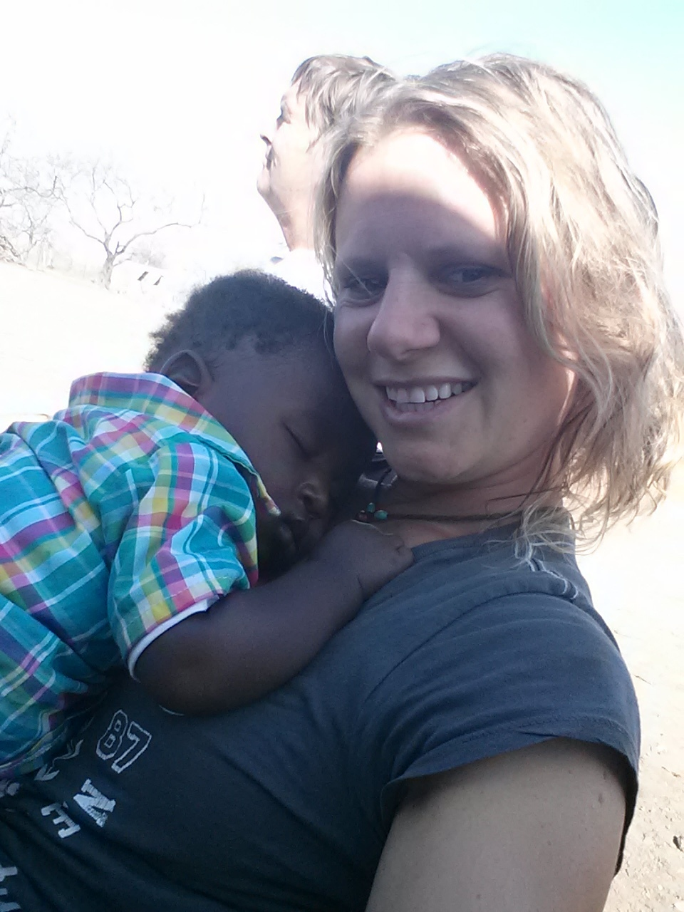 Kate in Swatziland, Africa taking a break from building a local playground to steal some snuggles from this little guy- who, sadly,  couldn't fit in my carry-on .