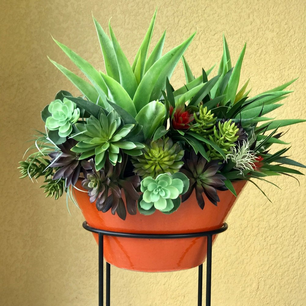 ARTIFICIAL SUCCULENTS IN A RED PLANTER