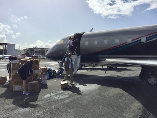 Unloading 10,000 Pounds of Aid at Isla Verde Airport