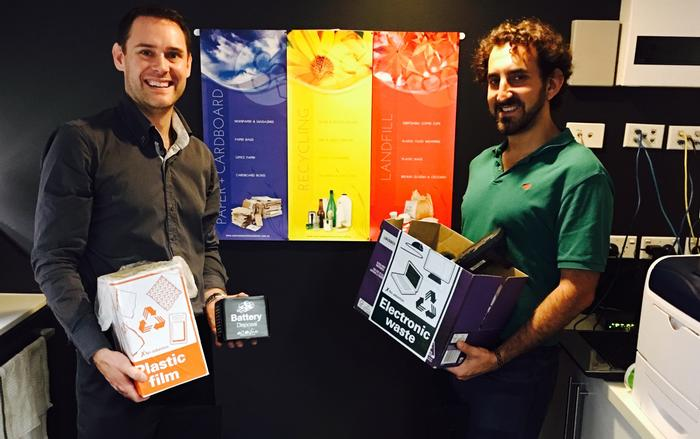 Team members Kyle Sawyer and Max Brownstein show off just some of our waste and recycling streams