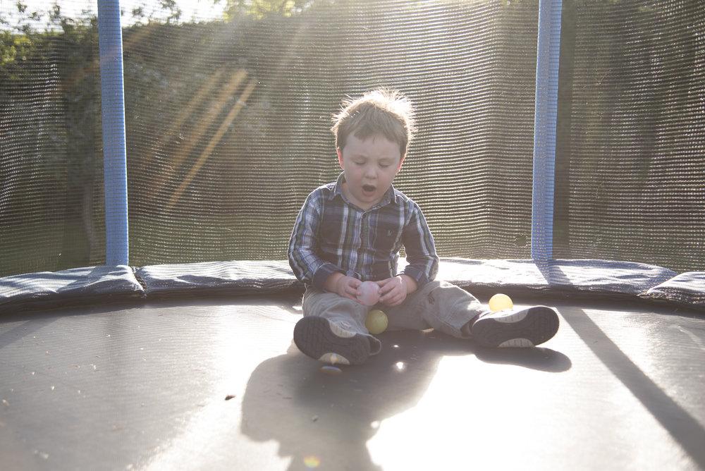 sally-hornung-photography-boy-trampoline-sunlight.jpg