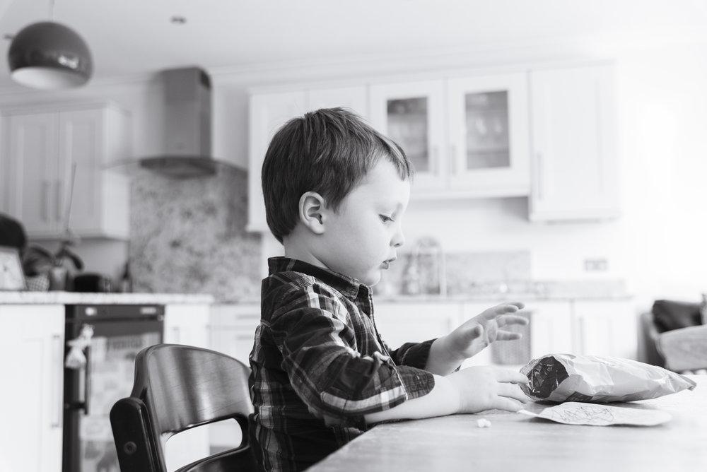 sally-hornung-photography-boy-table-bw.jpg