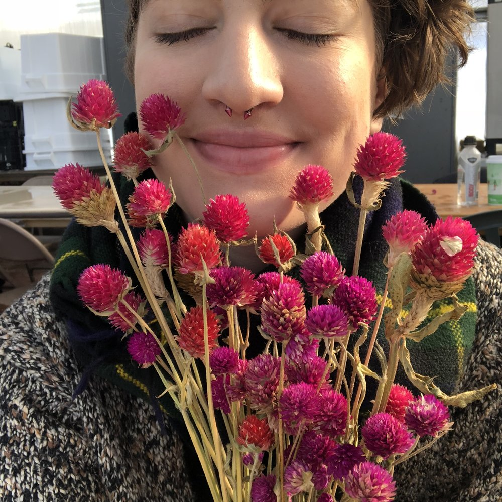 Me with some gomphrena we grew last summer and dried for CSA distrubution. I didn't know what gomphrena was seven months ago.