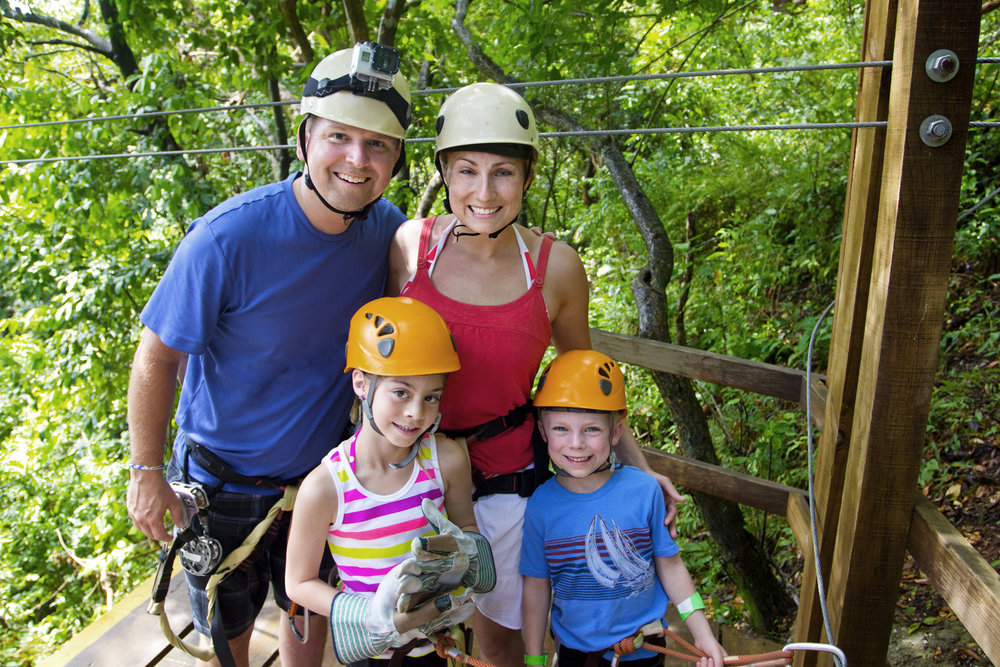 bigstock-Family-enjoying-a-Zipline-Adve-75432157.jpg