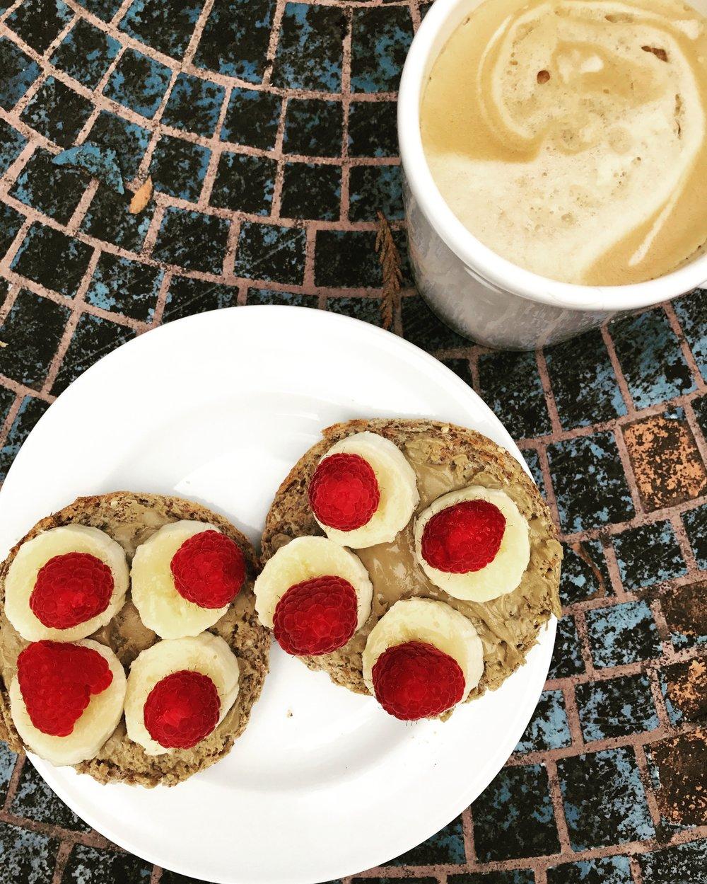Ezekiel English Muffin with SunButter, Banana, and Raspberries!