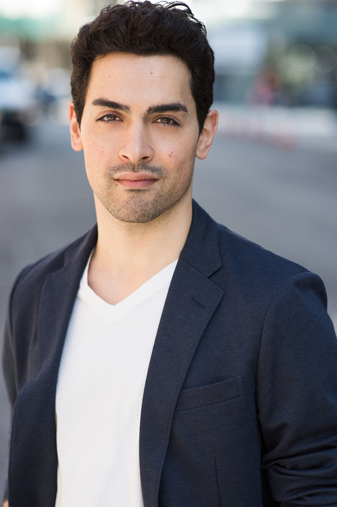Same outfit, but a different expression changes everything in a headshot. Here's his young bachelor look.