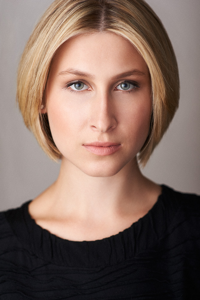 Theatrical/Legit Headshot of Actor Sofie - Notice the intense expression and dramatic lighting.