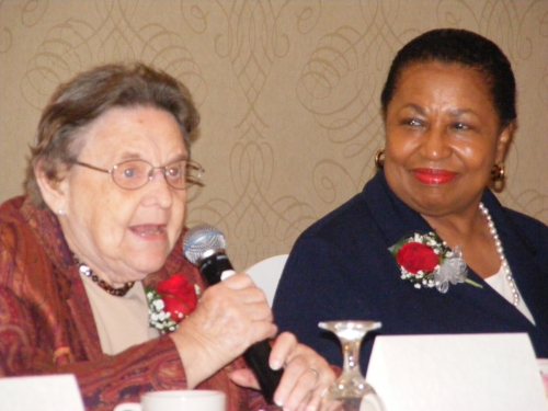 Helen Satterthwaite speaks while Carol Moseley-Braun looks on at WMW 2015