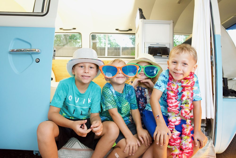 Brothers pose together in the Bradenton VW Bus photo booth