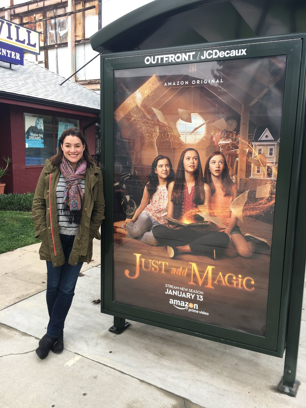 "Catia Ojeda next to an advertisement for ""Just Add Magic."""