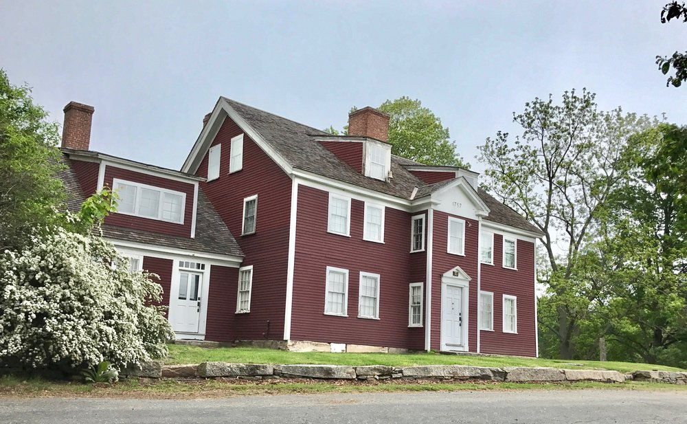Pictured Above:  Waters Farm, a hilltop homestead in Sutton, Massachusetts that overlooks beautiful Lake Manchaug, was built in 1757 by Stephen Waters and is listed on the National Register of Historic Places.