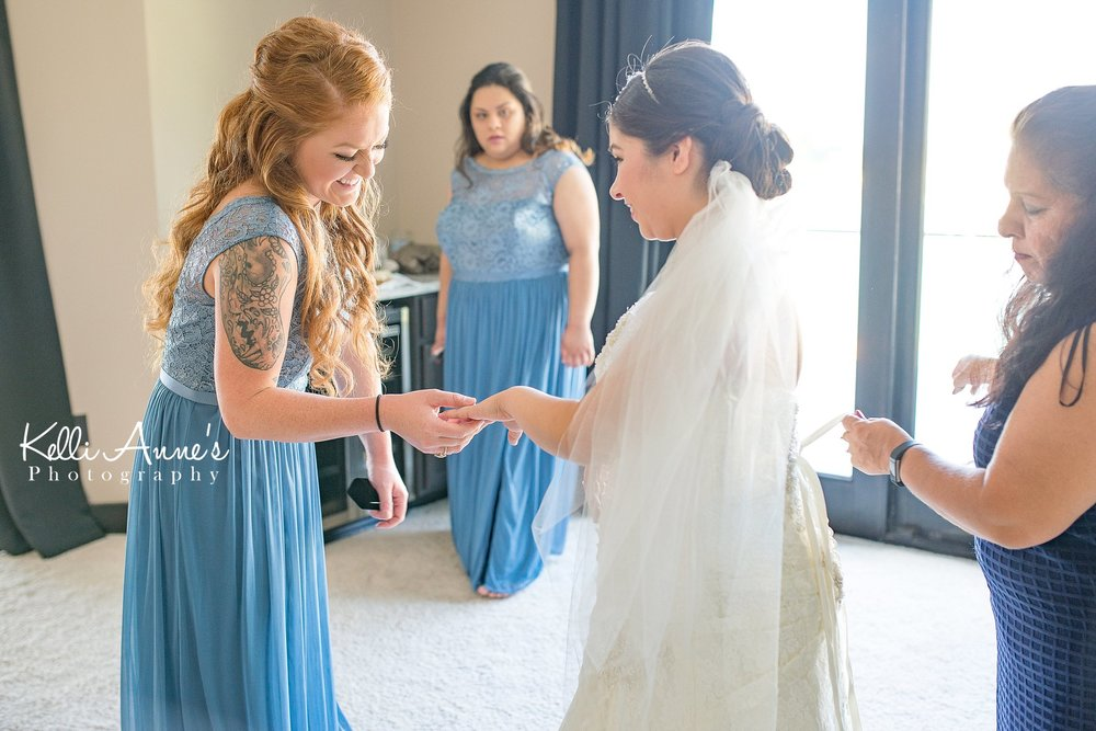 Bride getting ready, putting on dress, Maid of Honor, MOH, Ring, Bridesmaid, Mother of Bride, MOB, Slate, Blue, Natural Light, Bridal Suit, Sunset Bluffs, Washington MO