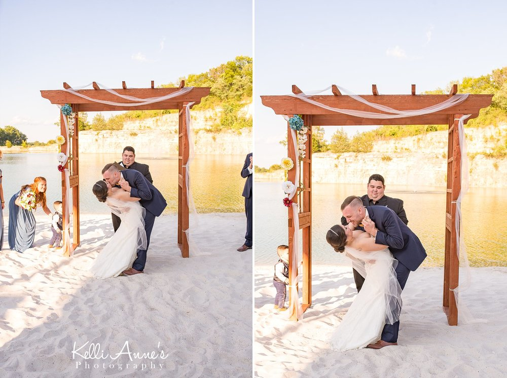 Beach Wedding, Ceremony, First Kiss, Husband and Wife, Wood Arbor, Kiss and Dip, White sand, lake, bluff, sunset bluffs, washington mo