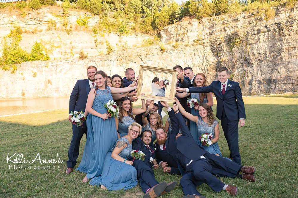 large bridal party, bride and groom, framed, 8 bridesmaids, 8 groomsmen, bluff, sunset bluffs