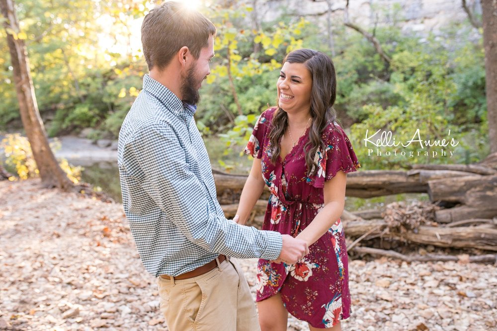 Engagement Session, Fall, Capen Park, Columbia MO, River, Creek, Log, down trees, Trees, Floral Dress, Black and White, Black heels, laughing