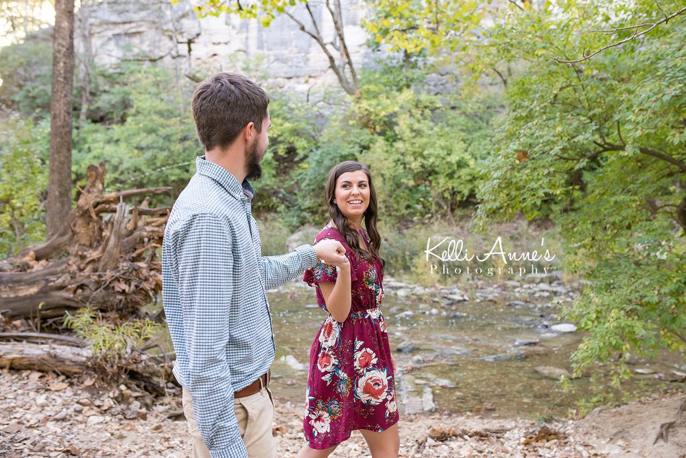 Engagement Session, Fall, Capen Park, Columbia MO, River, Creek, Log, down trees, Trees, Floral Dress, Black and White, Black heels, walking