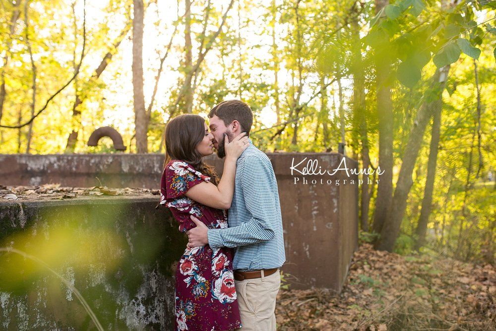 Engagement Session, Fall, Capen Park, Columbia MO, woods, warm, sun kissed, sunset, Trees, Floral Dress, Rust, kissing, romantic
