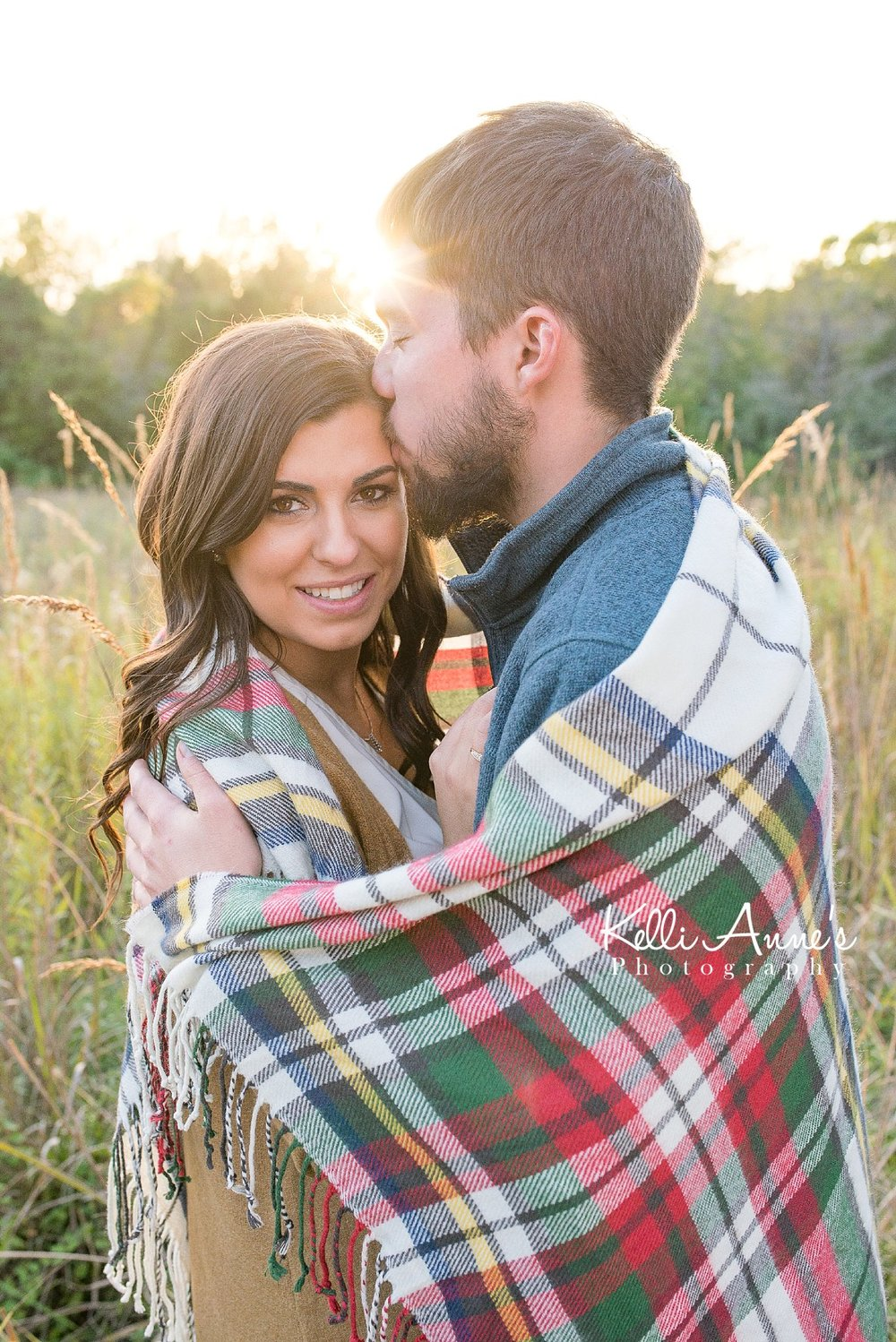 Engagement Session, Fall, Capen Park, Columbia MO, field, blanket, plaid blanket, woods, warm, sun kissed, sunset, Trees, Floral mustard sweater, jeans, boots