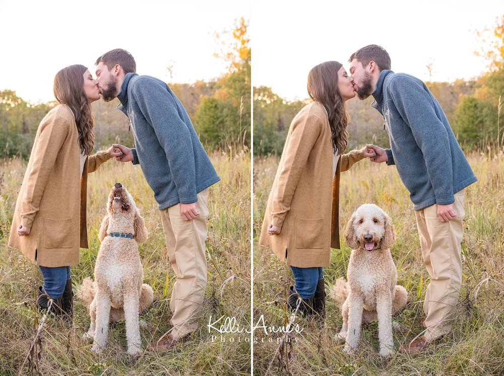 Engagement Session, Fall, Capen Park, Columbia MO, field, blanket, plaid blanket, woods, warm, sun kissed, sunset, Trees, Floral mustard sweater, jeans, boots, kissing, goldendoodle