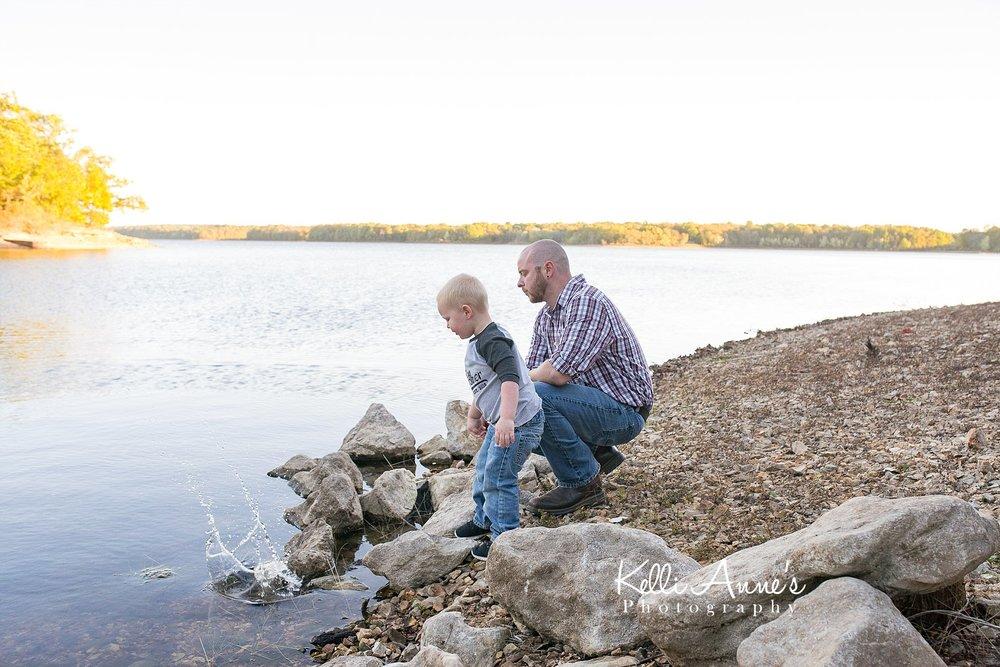 skipping rocks, throwing rocks, lake, water bank, rocks, father son, splash, fellows lake, springfield mo