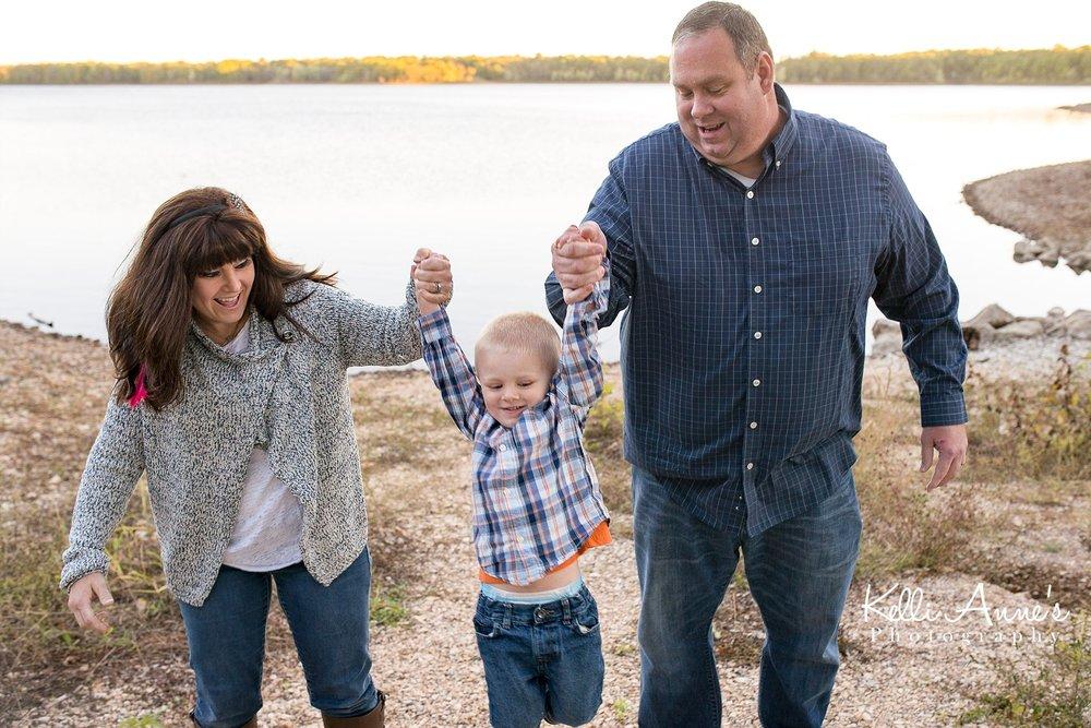 Family of 3, swinging, 3 year old, mom, dad, lake, fellows lake, springfield mo