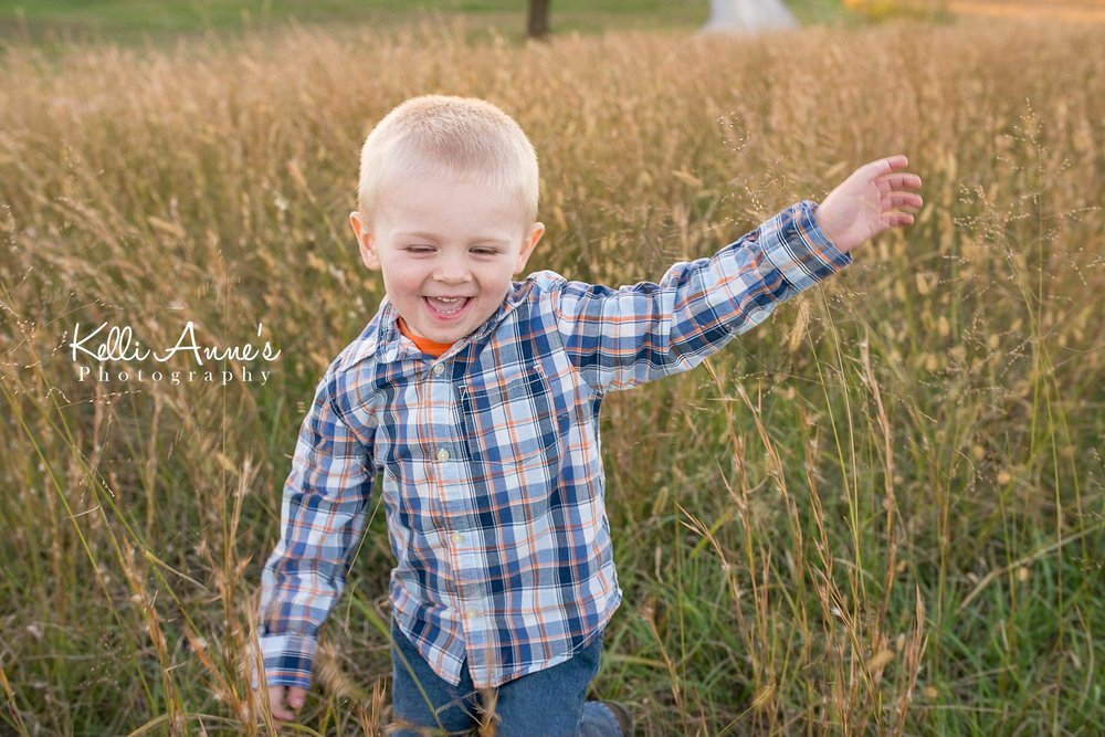 Playing in tall grass, dancing, laughing, little boy, 3 year old, swinging, field, fall, sunset, springfield mo, fellows lake