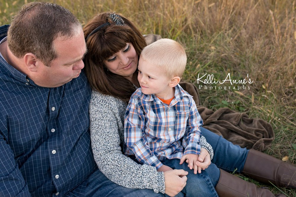 Family of 3, Springfield MO, Fellows Lake, Sitting, Brown blanket, tall grass, family, mom, dad, little boy, fall, sunset