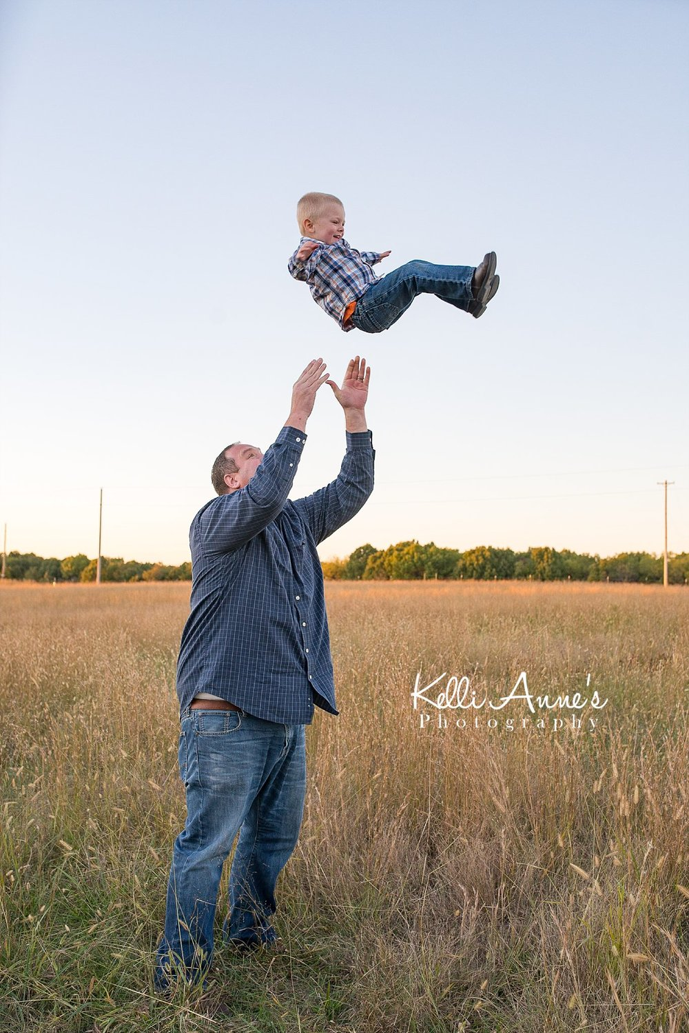 flying, dad, little boy, throwing up in air, flying, field, tall grass, sunset, little boy, fellows lake, springfield mo
