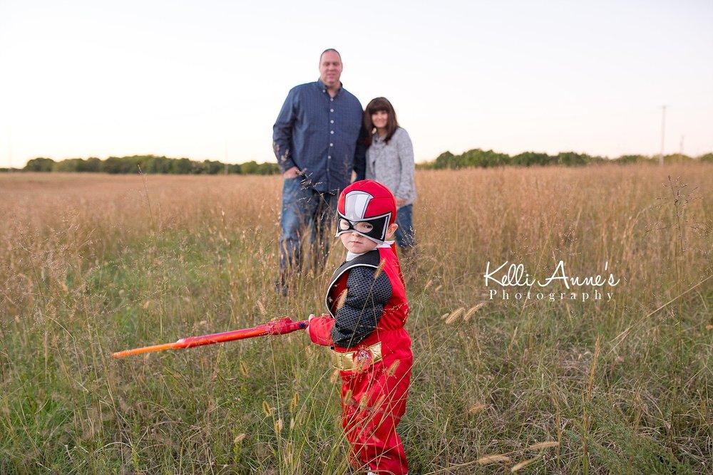 family of 3, power ranger, sword, tall grass, field, sunset, red power ranger, springfield mo, fellows lake