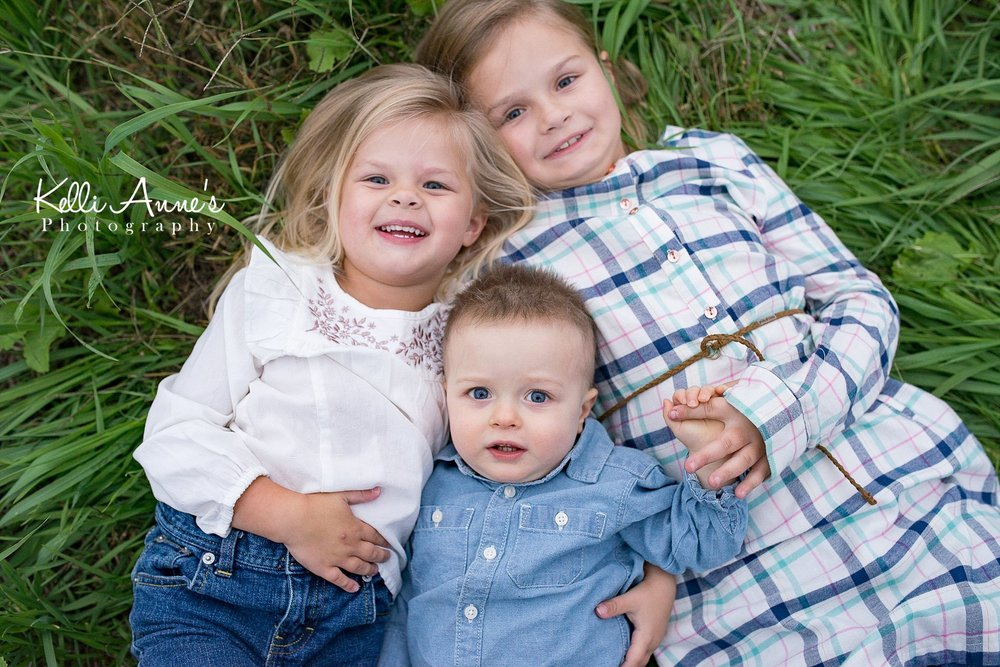 Siblings, younger brother, little brother, little man, little boy, sisters, older sister, best friends, grass, laying, springfield mo