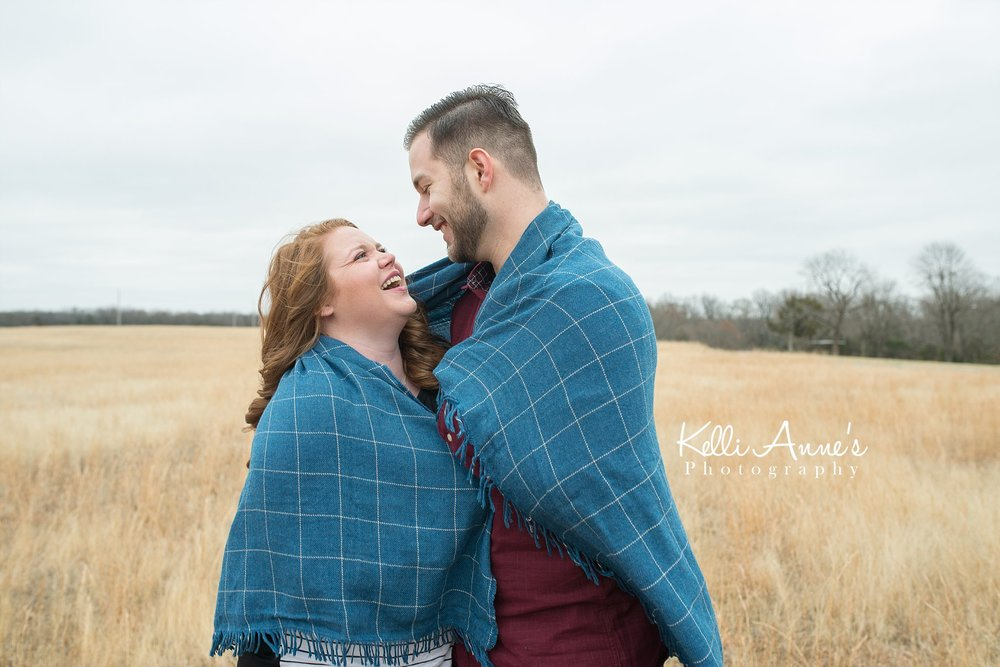 Winter engagement wrapped up in blanket  laughing springfield mo fellows lake