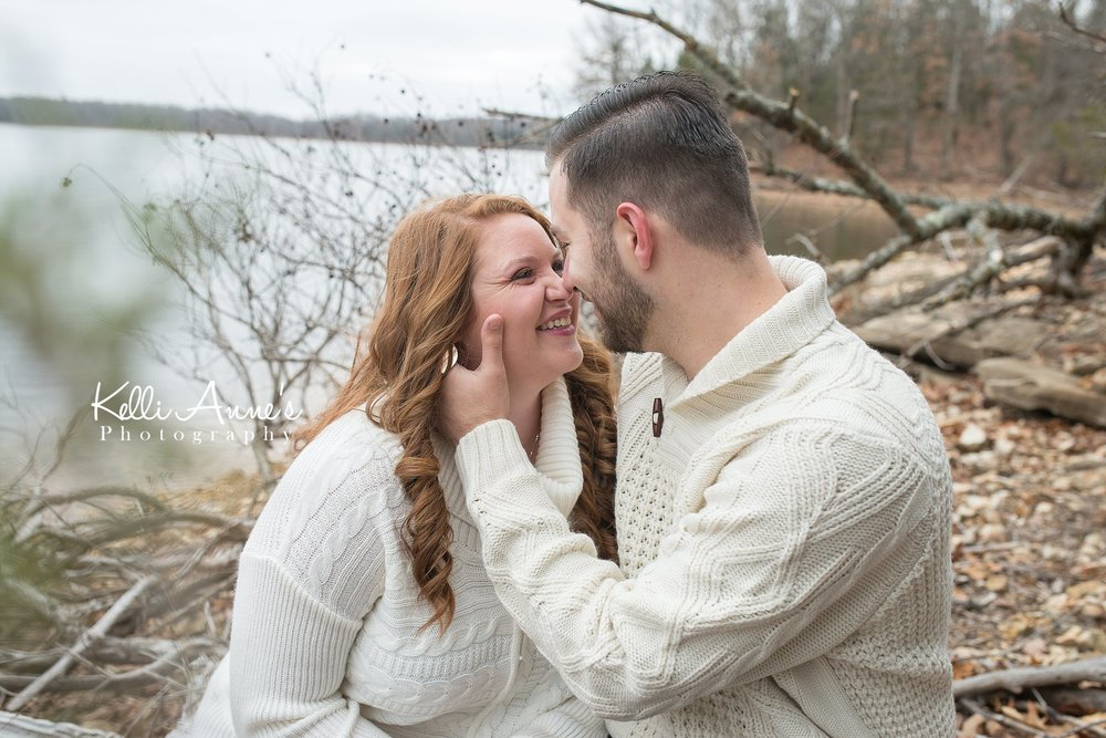 kissing engagement session down at the lake springfield mo fellows lake