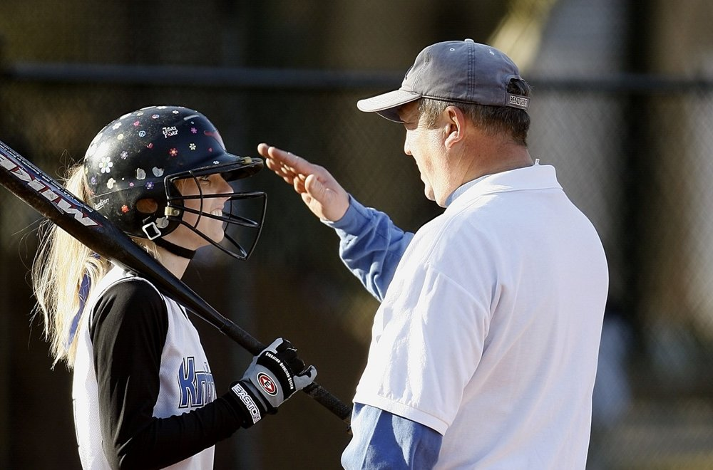 softball_coach_coaching_player_female_helmet_bat_batter-553113.jpg
