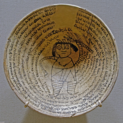 Incantation bowl with an Aramaic inscription around a demon. Nippur, Mesopotamia, sixth–seventh century. Ceramic. University of Pennsylvania Museum of Archeology and Anthropology. Photo by Marie-Lan Nguyen - Wikimedia Commons, released under CC BY 2.5.