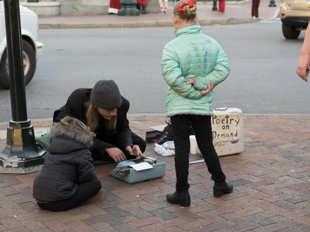 A busker on the streets of Asheville, NC. And yes, I did get a poem from him :)