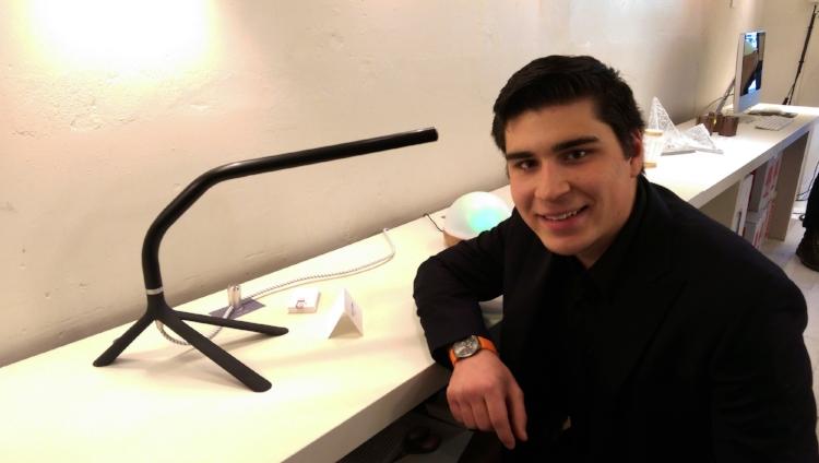 Co-op student Simon with aluminum prototype lamp
