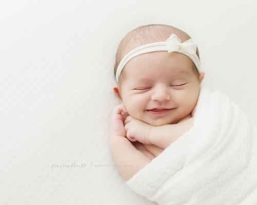 Newborn photographer okc baby smiles png