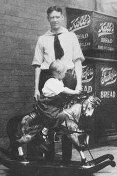 "David Lightfoot and his young son pose with ""Smokey,"" carved by Lightfoot to closely resemble several distinctive horses on PTC carousels carved between 1913 and 1916"
