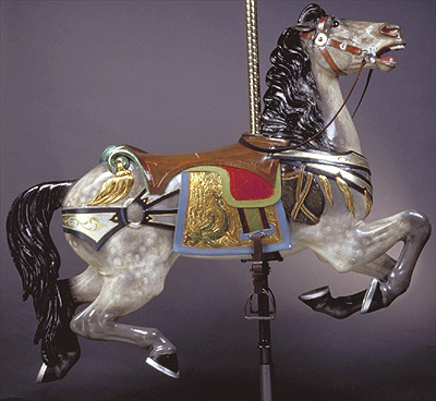 The Canteen Horse Available for adoption The sea serpent image seen on the saddle blanket is used much larger on the two chariots. It is believed to have been used in paintings on the original rounding boards, and has therefore been used on the recreated rounding boards.