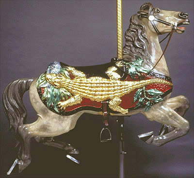 The Alligator Horse Adopted by: Cleo Cafesjian With its gold-leaf alligator (which also has glass eyes) and glazed foil-leaf fish, turtle and foliage, this horse is arguably the most distinctive on the carousel.